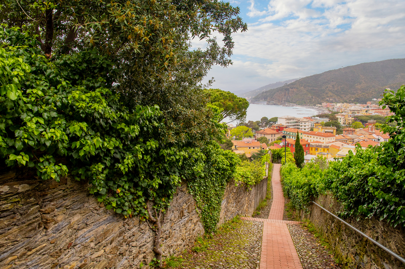 Panoramic view the Bay of Fairy Tales from the footpath of Punta Manara, with the rooftops of the old town of Sestri Levante, Genoa, Liguria, Italy