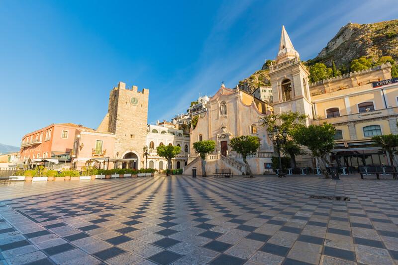 Taormina main square Piazza 9 Aprile, with San Giuseppe church and Corso Umberto street, Taormina town, Sicily, South of Italy