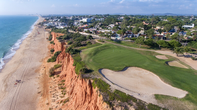 Aerial. View from the sky at the golf courses in the tourist town Vale de Lobo. Vilamoura
